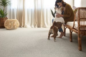 Lady with dog on Carpet floor | West River Carpets