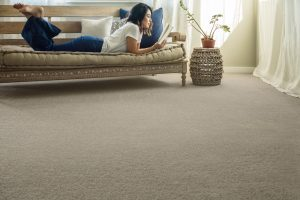 Lady reading book | West River Carpets