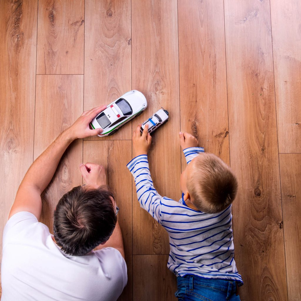 Father and kid playing with toycar | West River Carpets