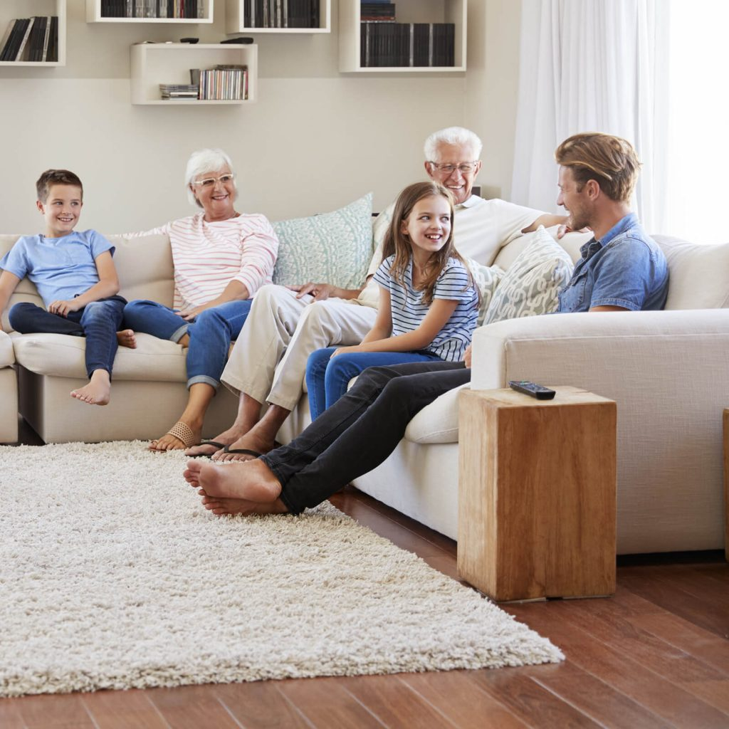 Family spending time together in living room | West River Carpets